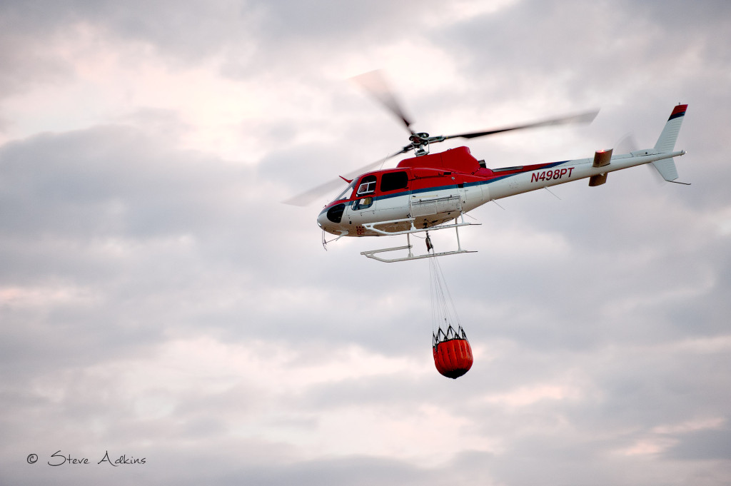 Firefighting helicopter with full bag of water.
